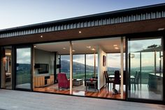 Hau Nui House, Wellington. When the homeowner isn't entertaining, a pivoting wall provides a division between the dining and living areas.