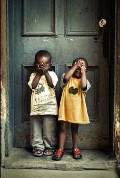 Two young children photographed in Nigeria, by Jide Alakihja, and is one of the photos included in the book Nigerians behind the lens.