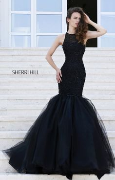 A mermaid dress that is chic and sophisticated is just what you need! Sherri Hill 32095 gives you a gorgeous silhouette and hugs your coke bottle curves! The matching beadwork that covers the entire body of the dress forms abstract flowers and roses all over the style. The sheer back has a cut out area that stop just at the bra line.