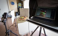 Food photography behind the scenes showing camera and computer setup