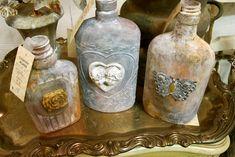 hummmm wonder if you could make from liquor bottle hot glue (to cover original design) and mottled paint... ummm