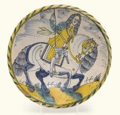 A SMALL ENGLISH DELFTWARE BLUE-DASH EQUESTRIAN CHARGER, LONDON OR BRISTOL, CIRCA 1680 painted  with a military commander in armour, possibly General George Monck, first Duke of Albermarle,  seated astride a rearing horse facing to the right, the reverse with a lead glaze 29.3cm., 11 1/2 in.diameter