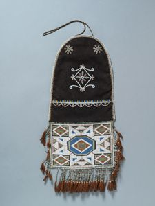 Embroidered Métis panel bag ca 1846, used for carrying personal medicines, tobacco, and flint and steel for making fire.  This Métis panel bag was collected in 1846 by Paul Kane.  It is believed he acquired it from the Métis in the Red River region in what is now southern Manitoba.