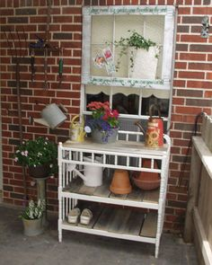Potting bench repurposed from changing table, topped with frame with chicken wire that was originally used to ship our cooktop.  Used fence boards made great shelves.  Changing table $20.00, chicken wire $3.00...value to me priceless!