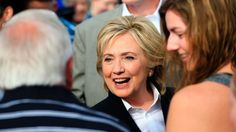 Democratic presidential candidate Hillary Rodham Clinton greets people Wednesday, Oct. 7, 2015, following a campaign stop at the Westfair Amphitheater in Council Bluffs, Iowa. (AP Photo/Nati Harnik)