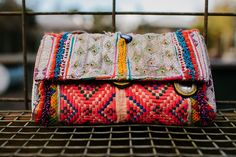 """in all of our searching for amazing textiles for our pillows, searching for inspiration, and for things we love, we have gathered some of our favorites that we want to share!  dress them up or go casual...these clutches are a find from india, of course!  vintage textiles repurposed into a clutch.  plum color cotton interior with an inner zip pocket.  magnet closure.  11"""" x 7""""all gathered goods are packed and shipped from our studio in portland, oregon"""