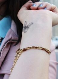 small butterfly tattoo on wrist. I can never find one i could actually see myself getting on my wrist. But this one is beautiful. I will get this :)