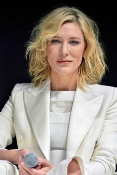 Cate Blanchett looked classy and elegant in a pristine white dress and elegant cream blazer as she took the stage to interact with audiences at the SK-II Change Destiny Forum in Tokyo, Japan. The social event was held on January 21, 2016....
