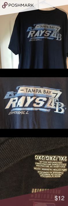TAMPA BAY RAYS Baseball MLB 2XL men's blue tshirt Going to Major League Baseball games is ridiculously expensive, but you don't need to spend a fortune to show you're a fan! Save money by shopping with saints vintage! TAMPA BAY RAYS Baseball size 2XL for those who need the comfort of a 2XL. Shirt is in premier preworn condition no rips, holes, stains, or tears. Perfect for a day at the game or lounging around the house. Don't be the only guy at the office without a Rays tshirt! MLB Shirts…