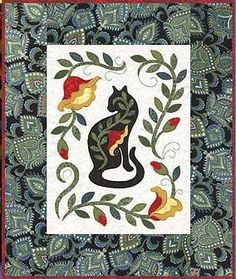 http://www.quiltpoetry.com/  Jane Spolar - Porcelain Cat pattern that I used in my wall quilt.