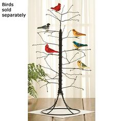"""Wire Tree - bendable, twisted-wire branches for seasonal decoration displays, or any time of the year. Black wire. Imported. 24""""H x 9""""base."""