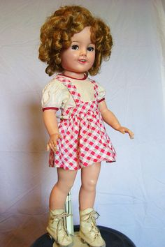 vintage doll - Ideal -  USA - Shirley Temple.  I remember loving the Shirley Temple movies; all of them.  She was a brilliant tap dancer.