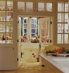 Flower arranging room/butler's pantry-vases and glass serving pieces in cabinets with glass doors-Traditional Home, July 2004-homeowner Donna Kaplan