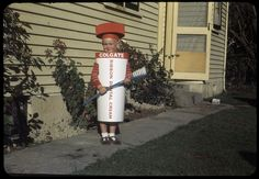 A child, Ian Crane, dressed as a tube of Colgate toothpaste, photographed ca by J A Jacques. Quantity: 1 colour original transparency/ie. Fancy Dress, Dress Up, Colgate Toothpaste, Historical Costume, Crane, New Zealand, Tube, The Past, Costumes