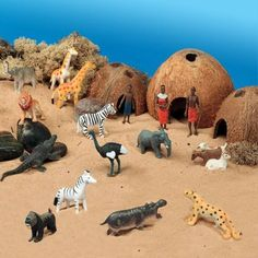 African Theme Scene Kit for Small World Play - Journey into the African landscape and find out about village life.