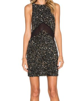 Black sequin cocktail dress; fully lined, sequined throughout, sheer mesh panel accent. Hidden back zipper closure.   Lana Sequin Dress by MLV. Clothing - Dresses - Night Out Clothing - Dresses - LBD Mississippi