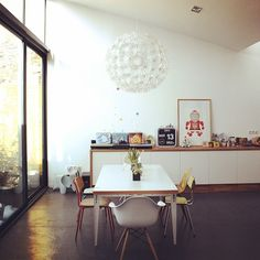 notre loft; loving the miss-matched chairs at the kitchen table