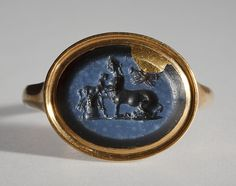 Female centaur, suckling a young centaur. Roman ringstone, 30 BC-200 Nicolo onyx, gold (modern gold ring). 1,2 x 1,5 cm Inventory number: I745