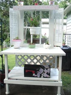 potting bench made from cutting an old door in half and decorating it with old shutters and scrap lumber