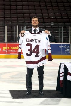 10.25.14 - Tomas Kundratek, the PNC #1 Star of the game, auctioning off his late 50s throwback jersey post game.  Photo courtesy of JustSports Photography