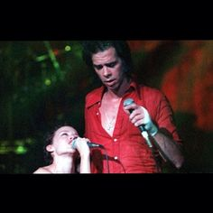 Nick performing Where the Wild Roses Grow with Kylie Minogue, 1996. #nickcave #kylieminogue #music #musician #wherethewildrosesgrow #singing #performing #photography #1996 #redshirt #legends
