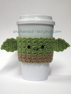 Free crochet yoda coffee cup cozy pattern by the enchanted ladybug baby child cozy crochet cup mug yoda baby yoda cup cozy the child crochet cup cozy mug cozy country road stitches Crochet Coffee Cozy, Coffee Cup Cozy, Crochet Cozy, Crochet Gifts, Cute Crochet, Coffee Cafe, Star Wars Crochet, Crochet Stars, Coffee Cozy Pattern