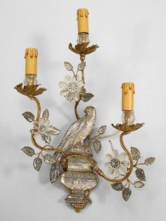 French lighting sconce (part of a pair), Maison Baguès. Mirrored glass and gilt metal 3 scroll arm wall sconces with parrot perched on urn backplate with floral decoration. Chandeliers, Antique Chandelier, Chandelier Lamp, Antique Lighting, French Chandelier, Wall Sconce Lighting, Candle Sconces, Wall Sconces, Mirrors