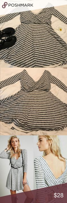 🔥🔥Reduced🔥🔥 Free People Striped Sweater Dress Gray and Cream combo make this mint knit fit and flare sweaty dress to die for. Deep V front and back. Crisscross wrap pull over meet fit and flare. Free People Dresses Mini