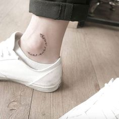 Tiny paper airplane ankle tattoo by Chaewa
