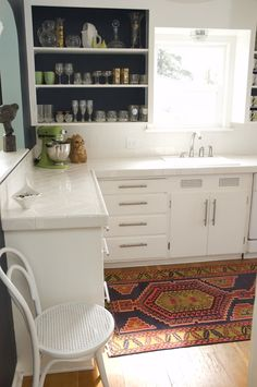 Updated retro kitchen.  great rug, open shelving