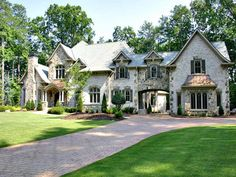 Old World style home with arched Porte-Cochere...like overall feel, gables, dormer treatment, flared rooflines, copper treatment over window.