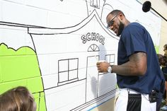 LeBron James of the Miami Heat works on a mural at the Coalition for the Homeless in Orlando, Florida.