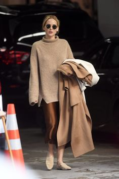Jennifer Lawrence Stepped Out In an Incredibly Stylish Fall Look — Turtleneck Sweater and Satin Skirt