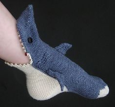 Socks that look like sharks are eating your leg and foot. I must have this. There is no other way for me to survive.
