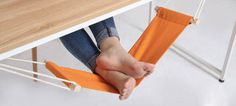 mini desk hamock for your feet!!  so cool  Some things for sale are pretty useless, but that doesn't mean we don't want them anyway.