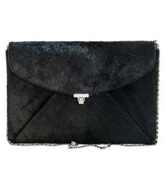 Ponyhair envelope clutch by L'Wren Scott. Black pony hair front flap gunmetal clasp optional silver chain shoulder strap grey leather lined one zid internal pocket envelope clutch bag. Material: Pony hair, metal and leather. #Matchesfashion