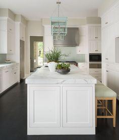 White kitchen with dark wood floors