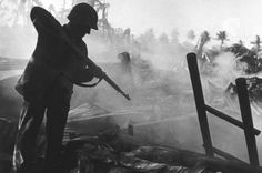 A US soldier looks for Japanese troops during the battle of Saipan Island, 1944 (Magnum Photos)