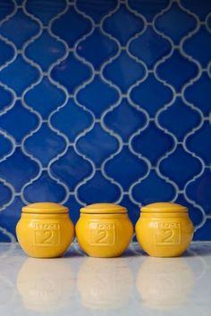 Blue and yellow kitchen – so pretty.  Love this backsplash pattern.