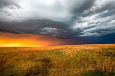 A prairie landscape is drenched in golden sunlight as a thunderstorm advances on a spring day in Kansas. Storm Photography, Landscape Photography, Night Sky Photos, Spring Day, Thunderstorms, Print Pictures, Sunlight, Wall Art Decor, Kansas