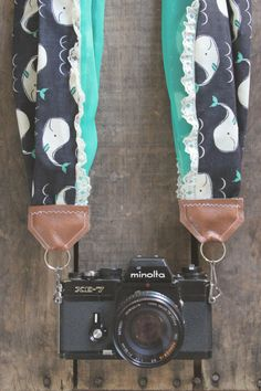 """Handmade, one of a kind, scarf camera strap in """"Whales, Green and Lace"""" with a cotton and chiffon scarf and faux leather. Suitable for small to medium DSLR camera bodies. Hardware included."""