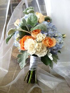 wedding bouquet with blue hydrangeas and roses from The Flowergirl