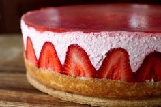 Strawberry Yogurt Mousse Cake: bottom layer is a buttery and crisp shortbread cookie crust.  There is a thin layer of strawberry jam adhering a light white cake to the cookie bottom.  Fresh strawberries line the perimeter of the cake bringing a pop of color and excitement.  The majority of the cake is made up of a smooth and slightly tart strawberry yogurt mousse.  And a transparent strawberry gelatin tops the cake and brings everything together.