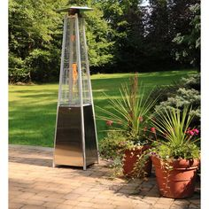 Pyramid Propane Patio Heater in Stainless Steel - your outdoor entertainment season with Hanover's collection of pyramid propane patio heaters. Its high-performing BTUs of heat make this patio heater an essential a Propane Patio Heater, Outdoor Entertaining, Bedding Shop, Bath Towels, Backyard, Outdoor Structures, Stainless Steel, Base, Gardening