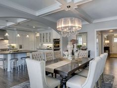 Traditional Dining Room with Hardwood floors, Chandelier, High ceiling, Crown molding, Box ceiling, Carpet