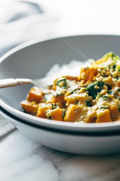 Creamy Thai Sweet Potato Curry - spinach and sweet potatoes covered with a velvety coconut curry sauce. Healthy, easy, vegetarian/vegan.   pinchofyum.com