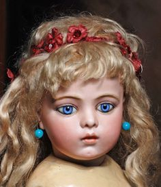 "FRENCH BISQUE BEBE BY BRU ~ MARKS: None, 19""T. Bisque socket head, cornflower blue spiral-threaded paperweight eyes....Bru wooden + composition jointed body which is unmarked....COMMENTARY: Exquisite, early face w/superb modeling, pale complexion + most beautiful blue eyes....c.1888"