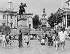 People cooling off in the fountains in Trafalger Square London England in the Hot Summer of 1976