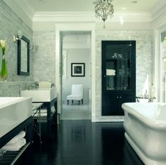 Black lacquered flooring in bathroom