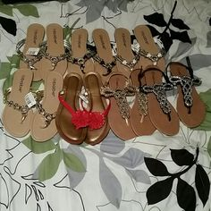 8 pairs of cute size7 assorted sandals 3 pair are brand new with tags Babe brand come in white,silver and gold!! :-) 1 pair of BABE black sandals, ALFANI red with flower &2 pair of WETSEAL gold, black BLING sandals :-)PRICE IS FOR ALL :-) Shoes Sandals